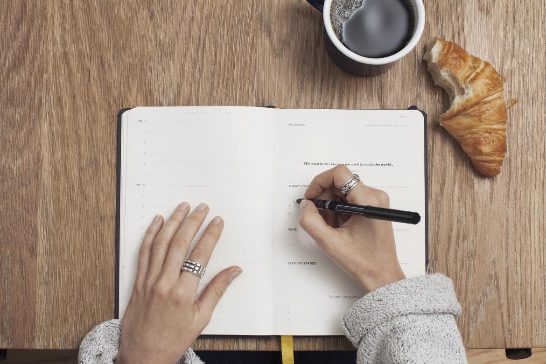 Person taking a coffee break. Caption: Taking breaks will help you avoid burnout.