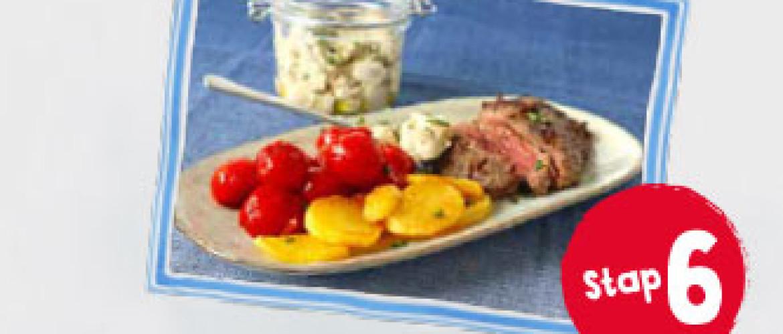 Biefstuk  met champignonsaus, gebakken  aardappels en balsamicotomaatjes
