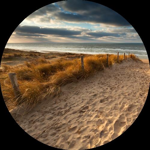 Groepsaccommodatie in Zeeland aan het strand verblijven