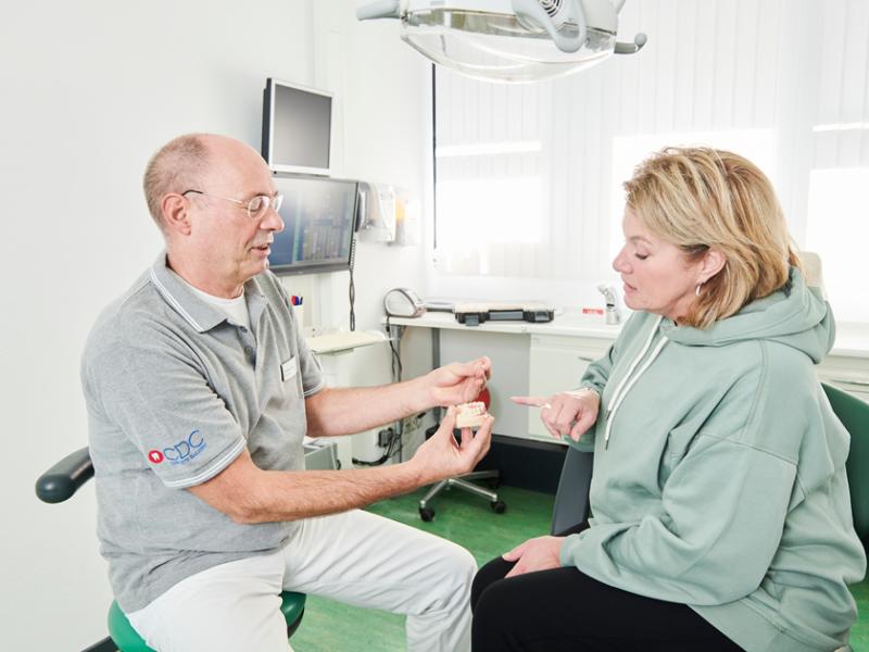 Tandheelkundige mogelijkheden bespreken met patient CDC