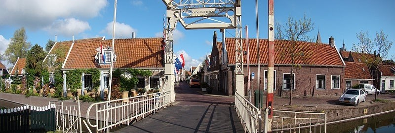 A panoramic shot of a street over a canal in Edam, Netherlands