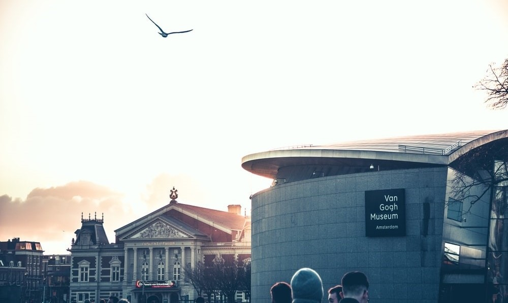 The Van Gogh Museum front entrance with the Concertgebouw in the background at sunset