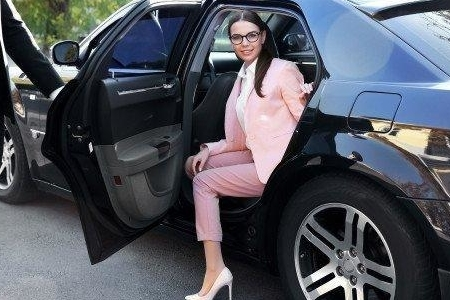 A chauffeur opening the car door