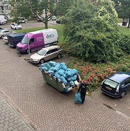 afvalcontainer opruimen en schoonmaken hoarding