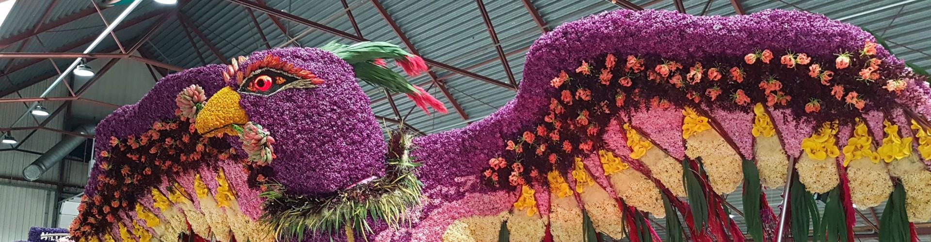 Bird on float created with bulb flowers