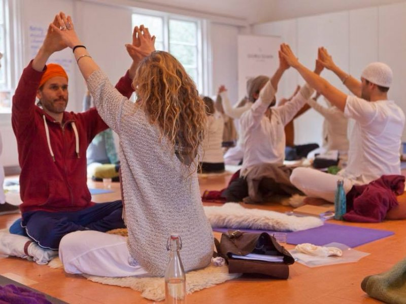 Students of the Kundalini Yoga Coach level 1- International Training doing a kriya