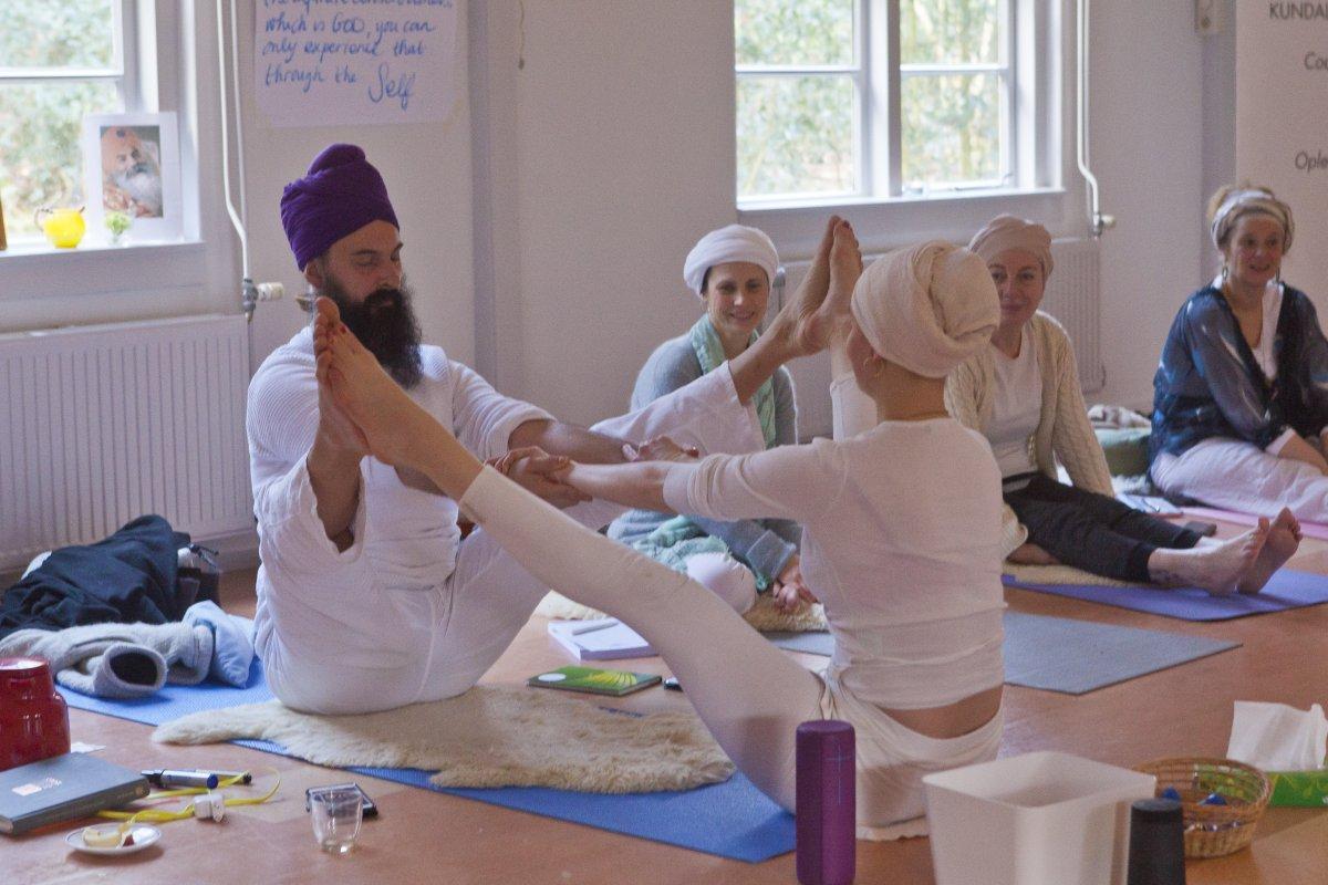 Kundalini Yoga coach and teacher Guru Gian doing a kriya with a student during the international training to become a Kundalini Yoga coach.