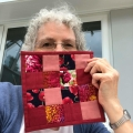angie-hale-with her quilted coaster made with the nine patch pattern in red and pink fabrics