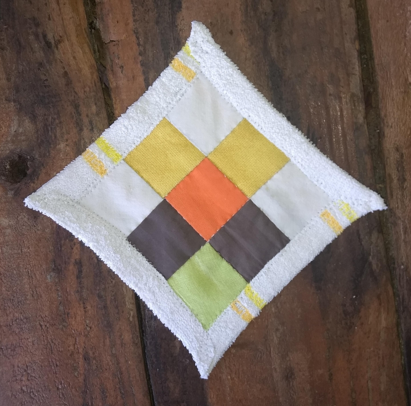 9 patch quilt block, made with yellow, white, orange, brown and green by Rianne from Kick Ass Quilts for the Comfort Blanket for Our Planet