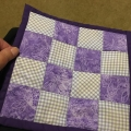 edna-quilt-front mini coaster made from grandchildren dresses with lessons kick ass quilt college in purple and white with bug fabric