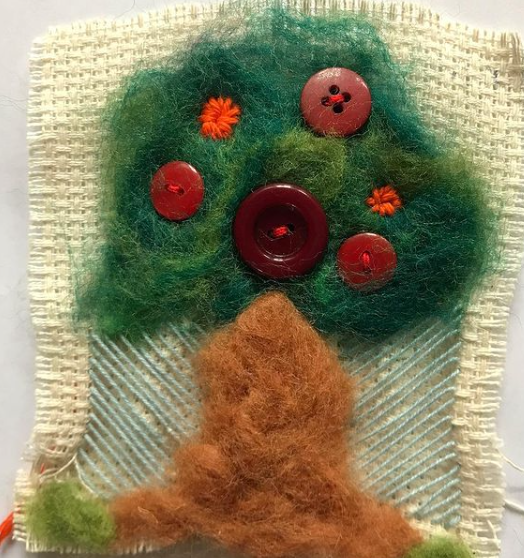 Little blanket made with felt and buttons by a primary school student