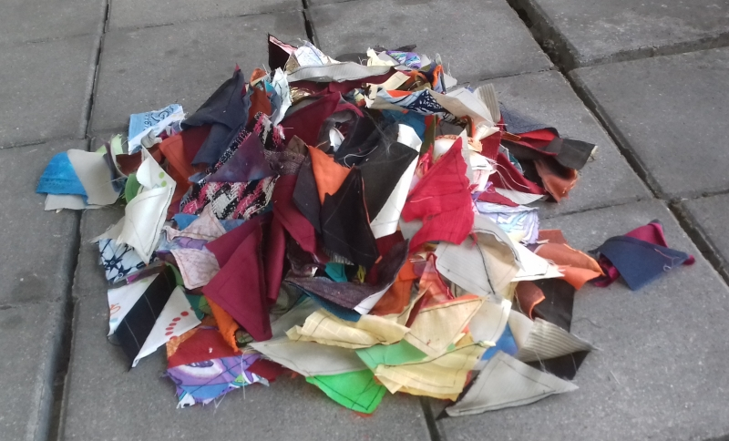 Pile of colourful fabric pieces of the ultimate scrap quilt