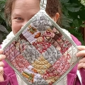 quilted potholder-nikki-shaw made with lessons kick ass quilts college in pink and grey. Quilted with circular lines