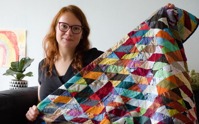 Rianne teacher of kick ass quilts showing of her first quilt made from scrap fabric