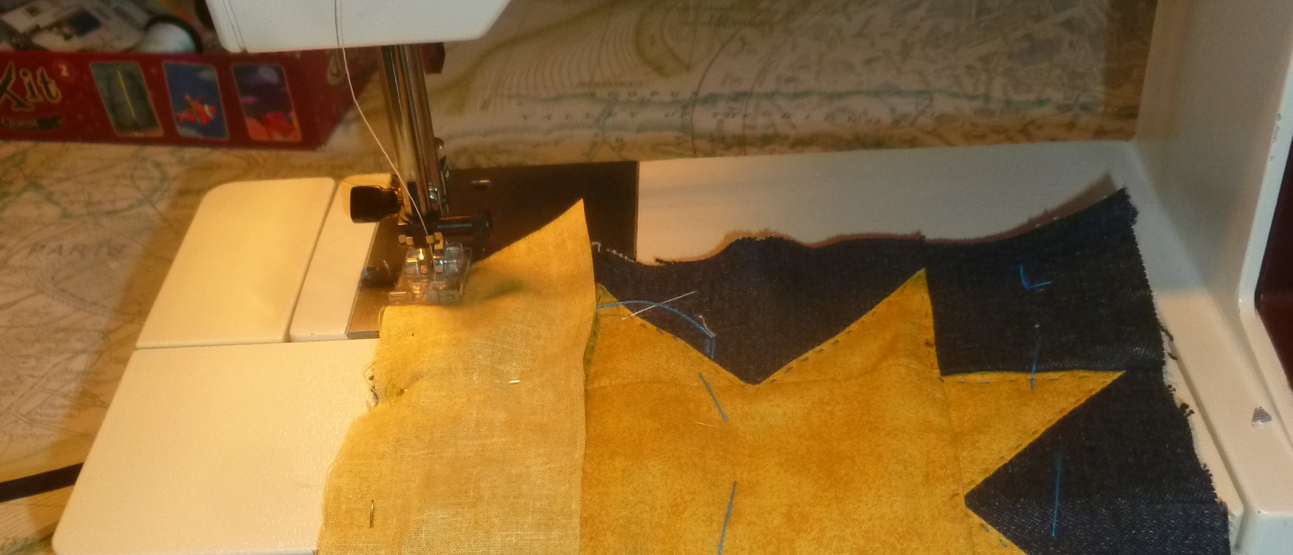 Pfaff sewing machine attaching a border to a mini quilt potholder