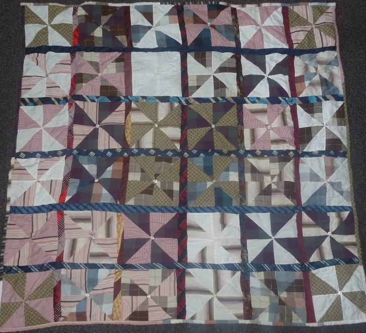 Shirt and Tie upcycle quilt with windmill blocks and sashing. Made in beige, white, purple colours