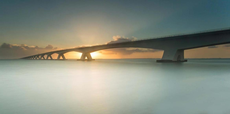Long exposure sea bridge sunset