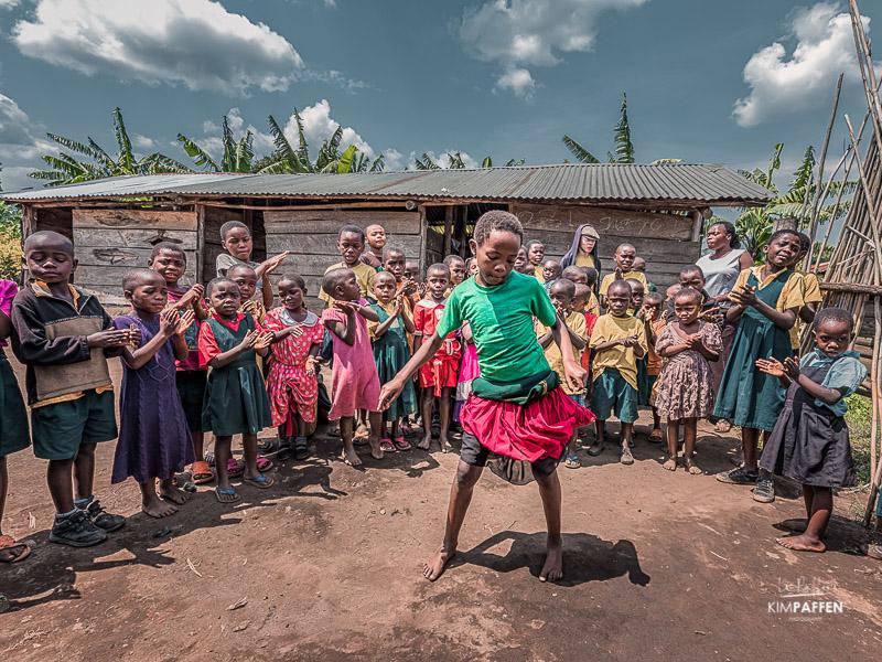 Dancing children at rural school near Kibale