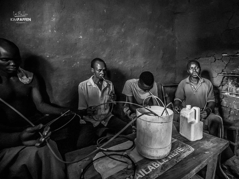Men drinking in Rural Uganda near Sipi Falls