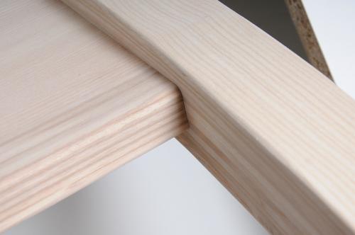 Detail van het hout van de massagetafel