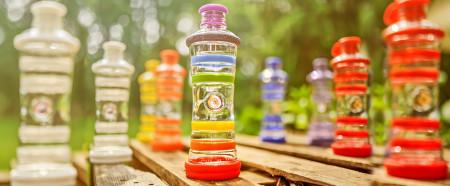 De i9 flessen met toegepaste TP Technology en kleurtherapie