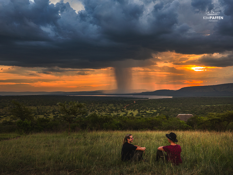 Watching an African sunset over the savannah with rains in the background