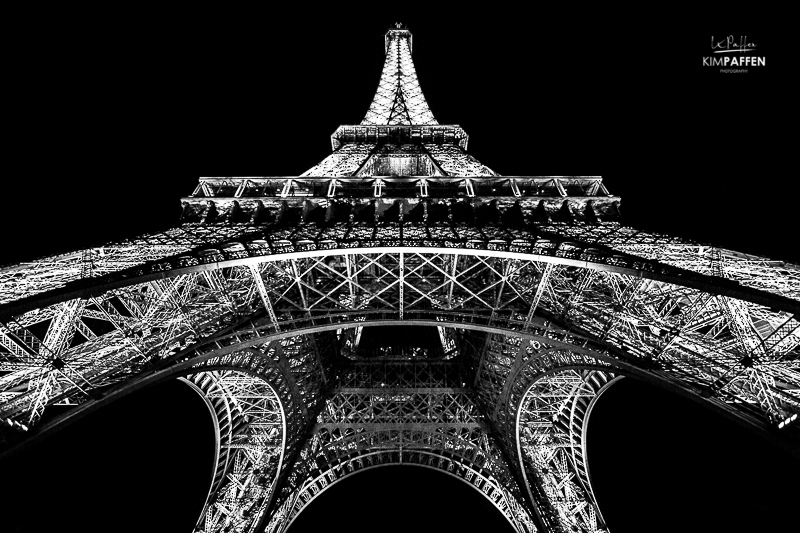 Take better travel photos by experimenting with you camera-angle, like this frog's perspective of the Eifel Tower in Paris (Europe Photography)
