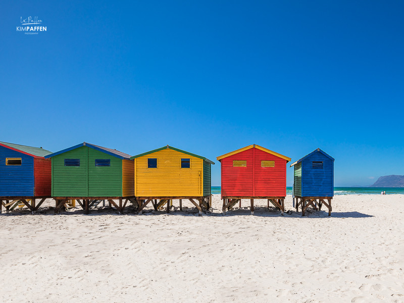 visit Muizenberg beach with colorful beach huts