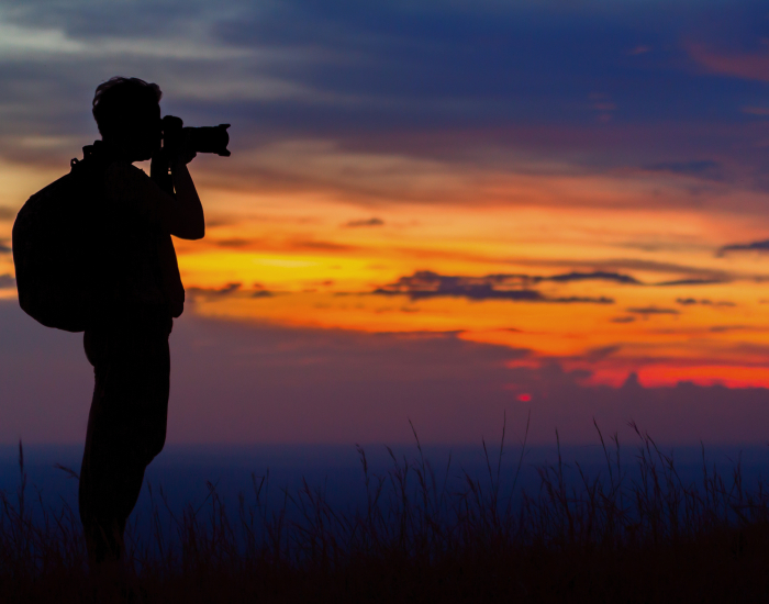 Travel Photographer shooting sunset at Sipi Falls photo location