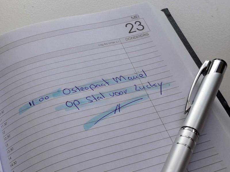 Foto van een agenda met een afspraak voor een osteopathie behandeling