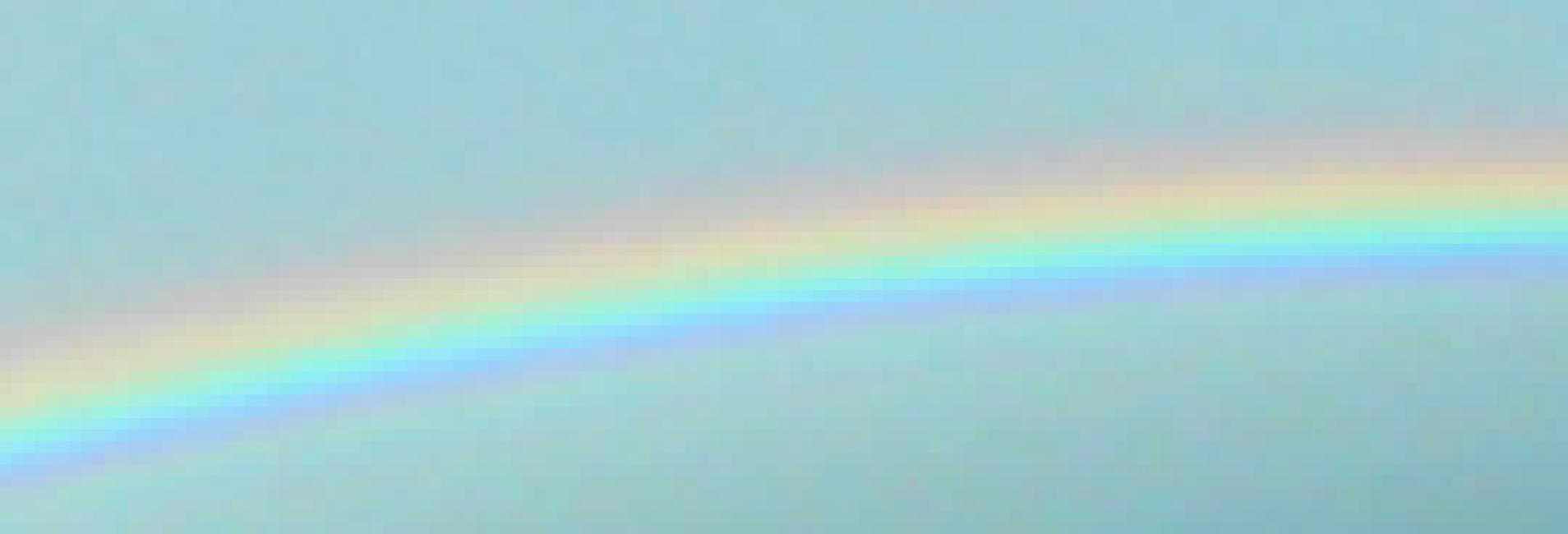 Rainbow detail soft shining in blue sky