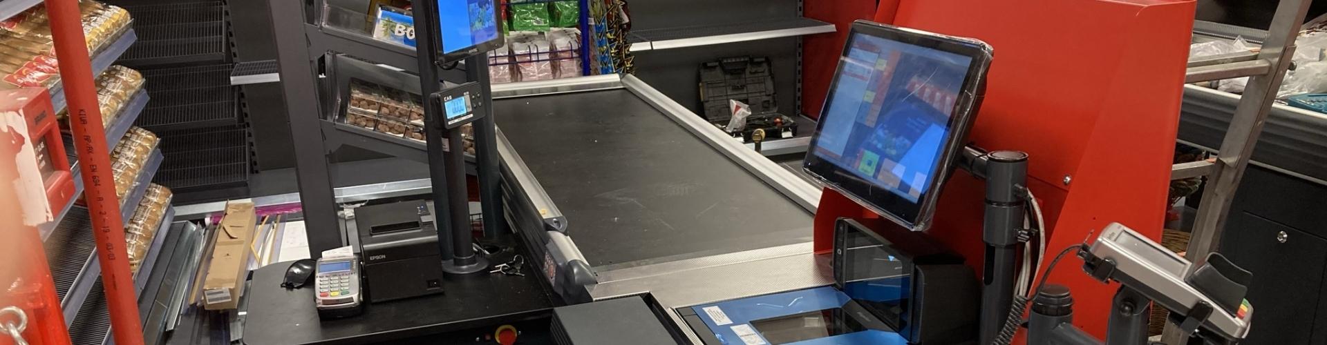 kassa met weegschaal en scanner