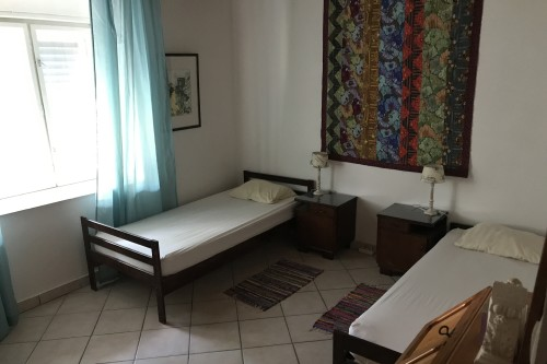 Mooie slaapkamers in Villa Punda voorzien van Wifi en minibar