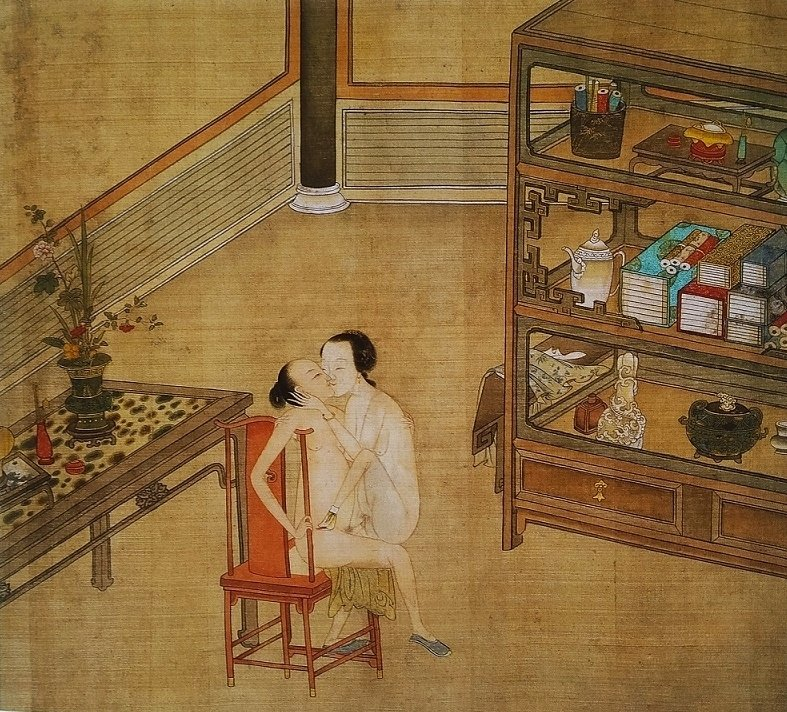 Chinese erotic art couple in a chair