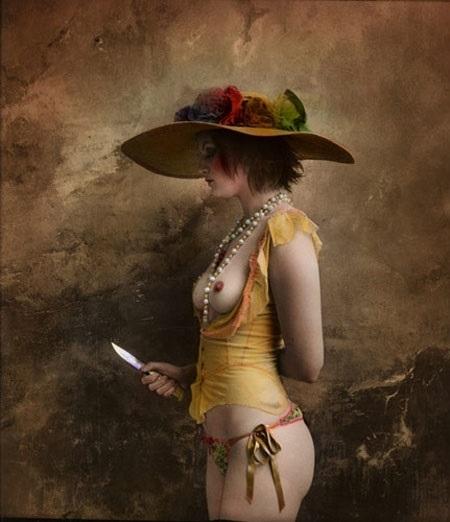 Jan Saudek semi nude female wearing a hat holding a knife