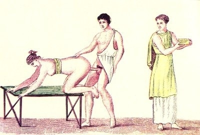 Man copulating with a woman from the rear while the boy is watching