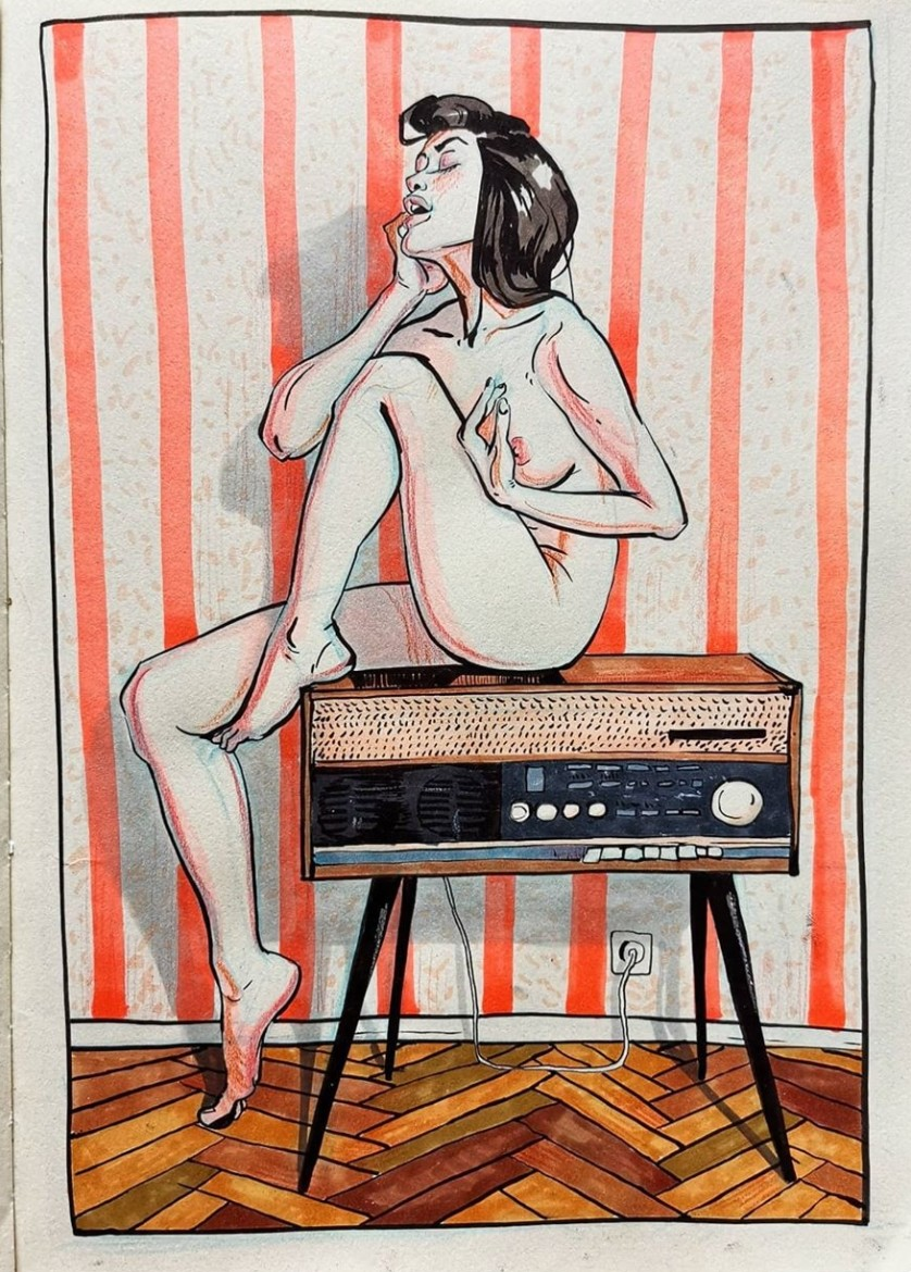 nude female sitting on a radio