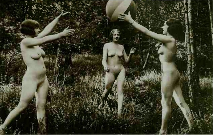 nudes playing with a ball in the forest