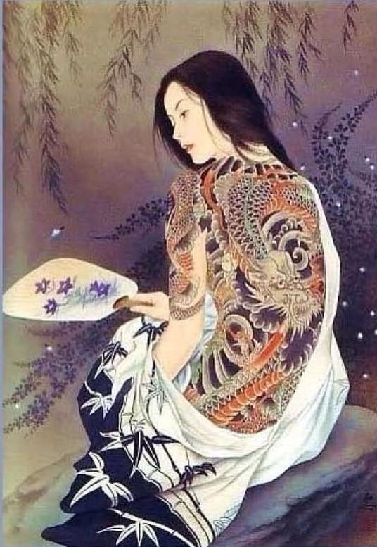 Ozuma kaname: tattooed female sitting on a rock holding a fan