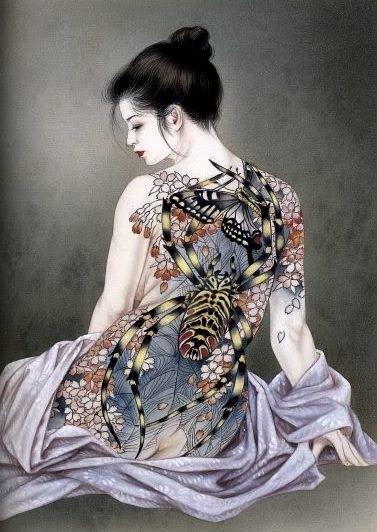 Ozuma kaname: sitting female with spider tattoo on her back