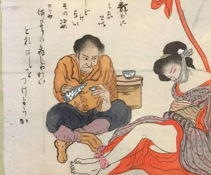 a tied female and her sake drinking torturer