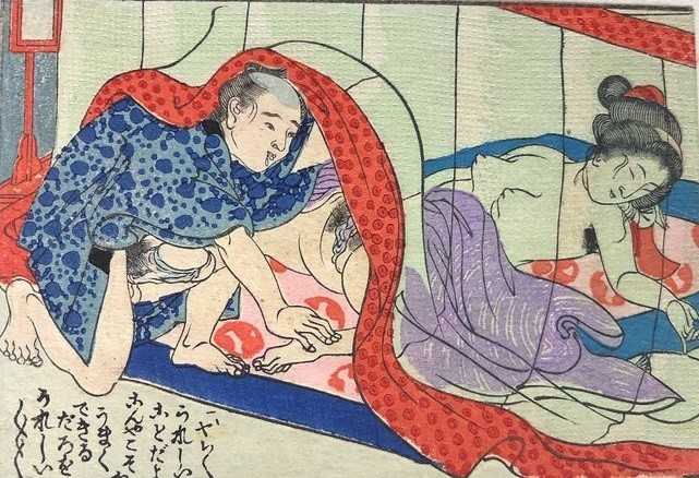 Aroused male examining the genitals of a sleeping female underneath a mosquito-net from the Meiji era