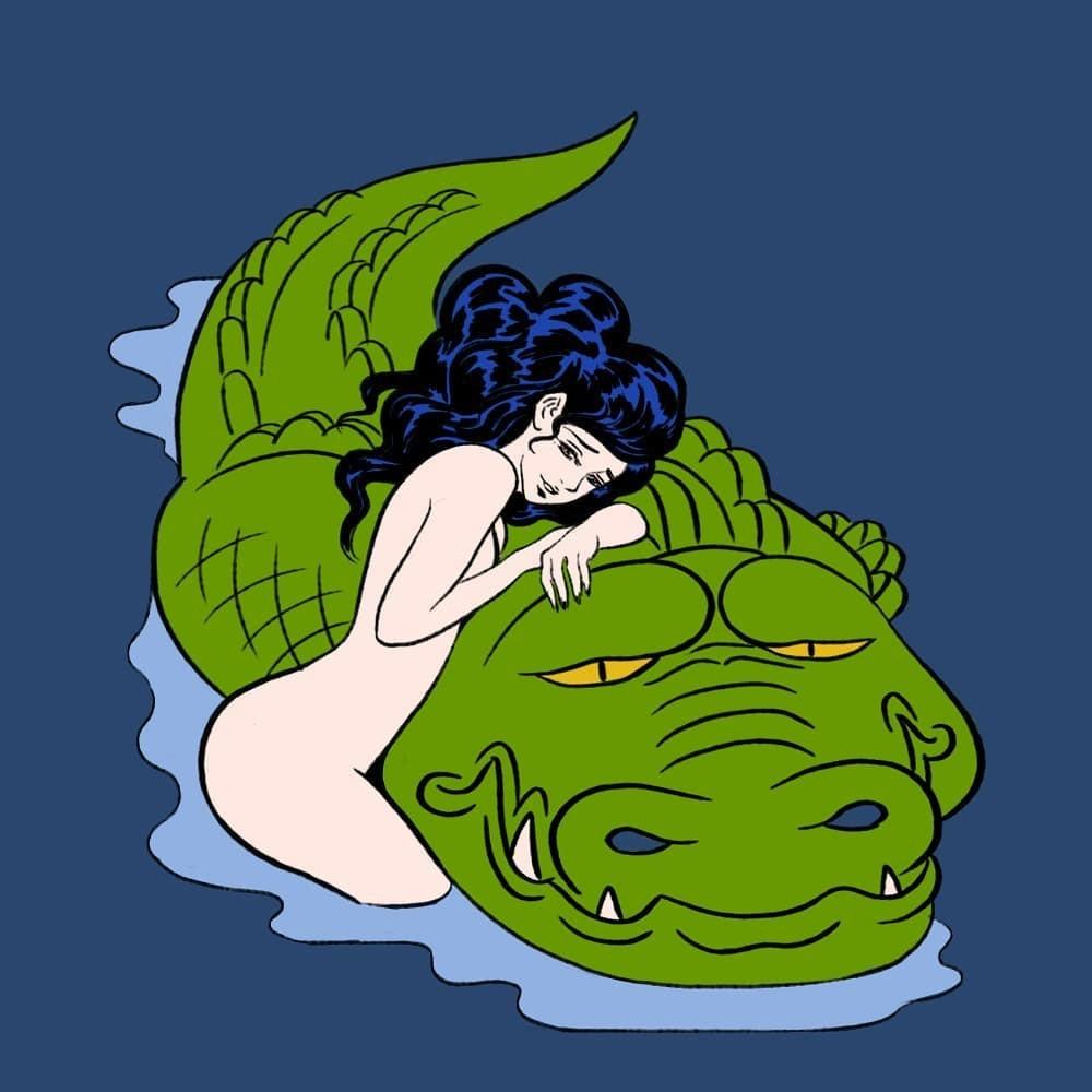 pigo lin: sensual nude female holding a crocodile