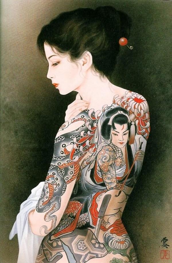 nude beauty with a back tattoo of a female warrior by Ozuma Kaname