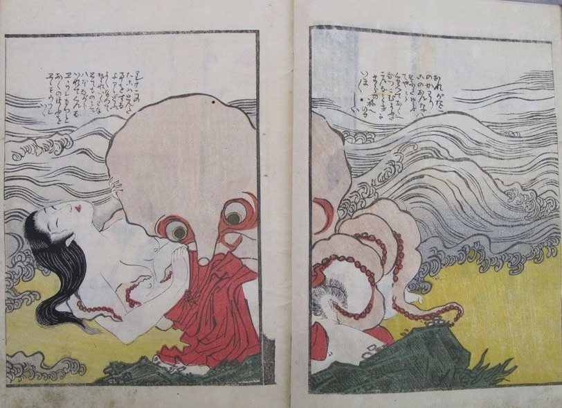 tentacle erotica: On the surf, a large octopus uses its tentacles to please an ama diver