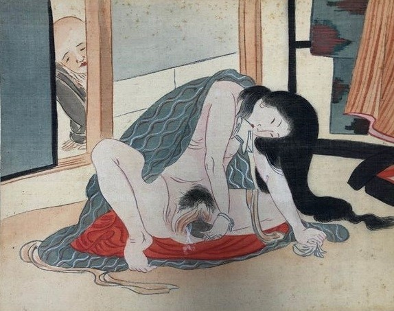 sensual female masturbation: female masturbating while being observed by a young monk