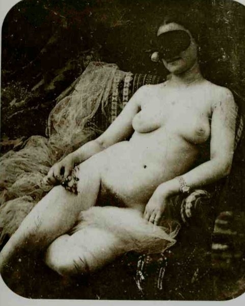 Naked woman lying in chair