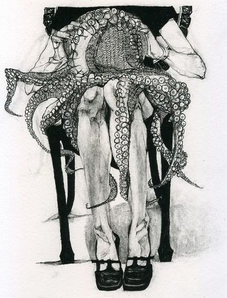 female sitting in a chair with an octopus on her lap