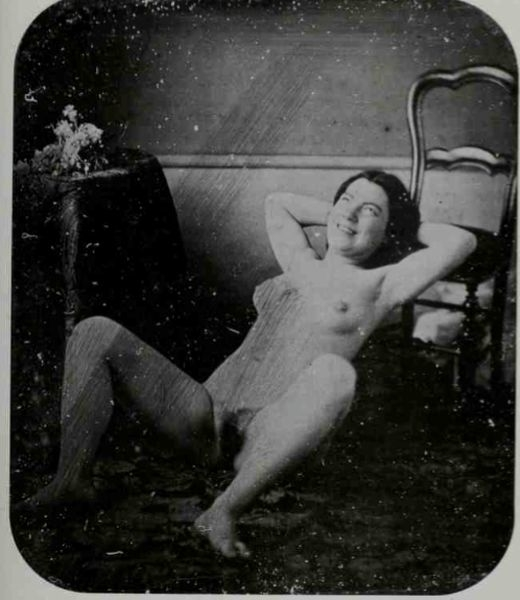 Woman lying casually on chair
