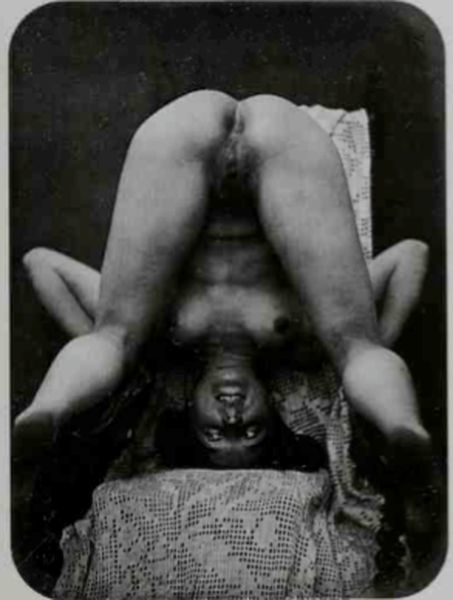 Posing nude on a chair upside down